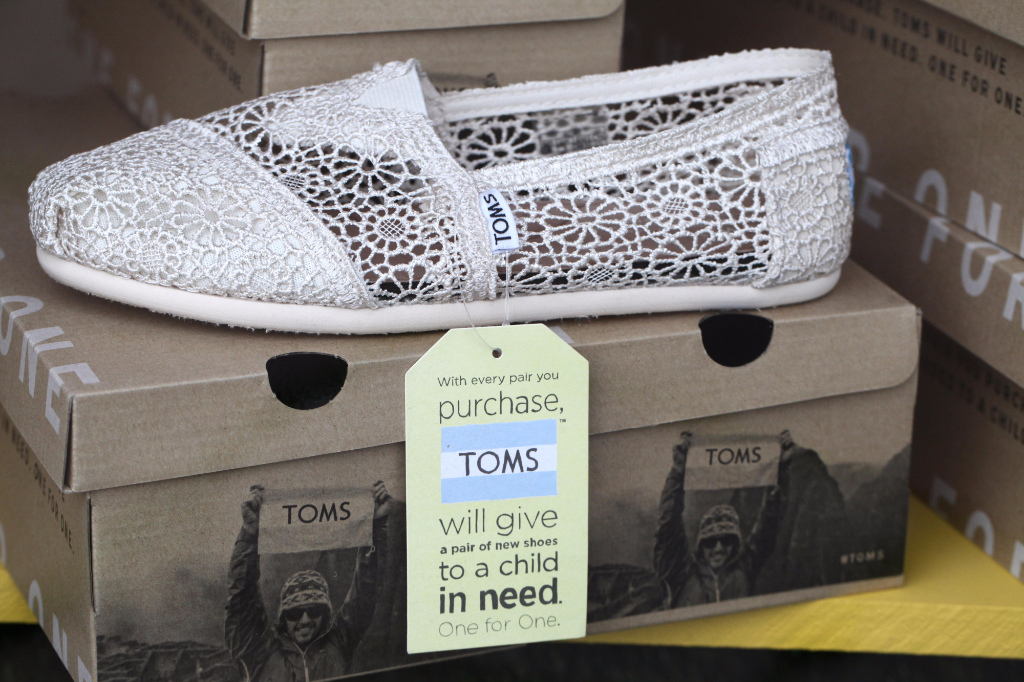 251fdc3c12 How does TOMS' aid-in-kind program impact communities? Photo Credit: Jackie  Ellis / Alamy Stock Photo