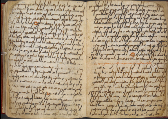 The beginning of Sūrah 12 (Sūrat Yūsuf, 'Joseph') showing the verse markers and also the red headings and circles which were added later (British Library Or.2165, folios 23v-24r)