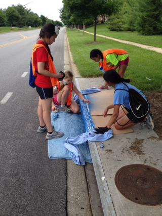 Painting the storm drain.