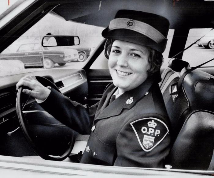 Joan Loftus in uniform in police car