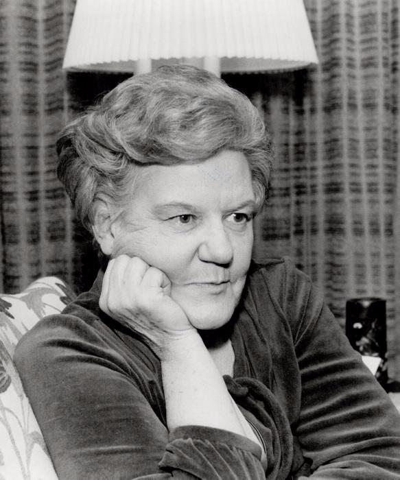 Portrait of Grace Hartman posing inside a room